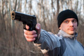 Man aiming gun — Stock Photo