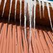 Big icicles on the roof — Stock Photo