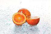 Orange in water — Stock Photo