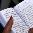 Open Hebrew Bible in womprayer hands — Stock Photo #2951606