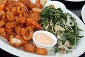 Fried Shrimps and calamary with salad — Stock Photo