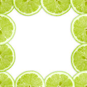 Abstract frame with cross of lime fruit — Stock Photo
