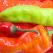 Background of multicolored chilli-peppers — Stock Photo