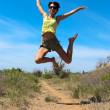 Beautiful girl jumping — Stock Photo