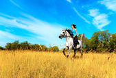 Girl on a horse — Stockfoto
