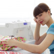 Tired girl and a sewing machine — Stock Photo #2691149