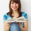 Girl holds a book on light background — Stock Photo