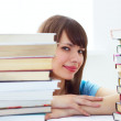The girl's face and a pile of books — Stockfoto