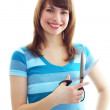 Smiling girl holding scissors — Stockfoto