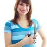 Smiling girl holding scissors — Stock Photo