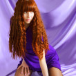 Beautiful girl on purple background — Stok fotoğraf