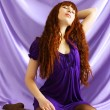 Beautiful girl on purple background — Stock Photo