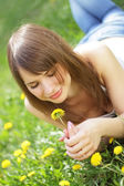 Beautiful young girl lying on grass — Stock Photo