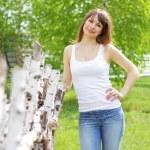 Beautiful girl and birch — Stock Photo