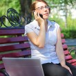 Business woman sitting on a bench — Foto Stock
