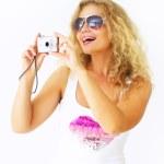 Stylish girl holding a camera — Stock Photo #3516738