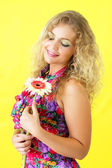 Beautiful girl and gerbera — Stock Photo