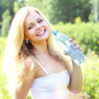 Beautiful girl holding a bottle of water — Stock Photo #3543588