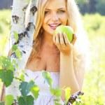 Beautiful girl holding green apple — Stock Photo #3543628