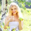 Beautiful girl holding a glass of water — Stock Photo