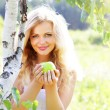 Beautiful girl holding an apple — Stock Photo #3545875