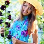 Beautiful girl next to mallow — Stock Photo #3577346