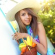 Beautiful girl holding a basket of fruit — Stock Photo #3577367