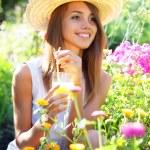Beautiful girl drinking juice — Stock Photo