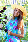Beautiful girl next to mallow — Stock Photo