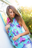 Beautiful girl holding a flower — Stock Photo