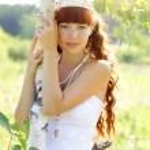 Beautiful girl near to a birch — Stock Photo