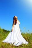 Bride in nature against the sky — Stock Photo