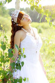 Beautiful girl near to a birch — Stock Photo