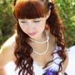 Beautiful girl in a wedding dress — Stock Photo