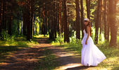 Girl in a wedding dress in the woods — Stock Photo