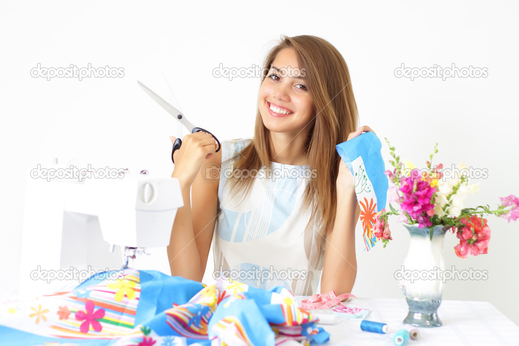 Girl and a sewing machine on a light background — Stock Photo #3621327