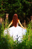 Girl in white dress in the forest — Stok fotoğraf