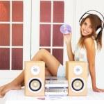 Beautiful girl listening to music — Stock Photo #3662809