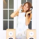 Beautiful girl listening to music — Stock Photo #3664748