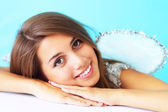 Portrait of a beautiful girl on a blue background — Stock Photo
