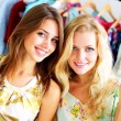 Foto Stock: Two beautiful girls out shopping