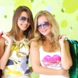 Стоковое фото: Two attractive girls on a green background