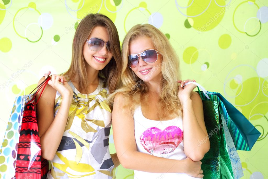 Two attractive girls on a green background — Stock Photo #3731100