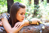 An attractive girl on the nature — Stock Photo