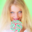 Beautiful girl holding lollipop — Stock Photo #3783203