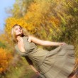 Attractive girl dances in the autumn forest — Foto Stock