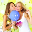 Stock Photo: Two attractive girls with a balloon