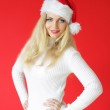 Santa girl on a red background — Stock Photo #3898503