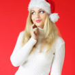 Santa girl on a red background — Stock Photo #3898507