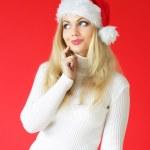 Santa Mädchen auf rotem Grund — Stockfoto